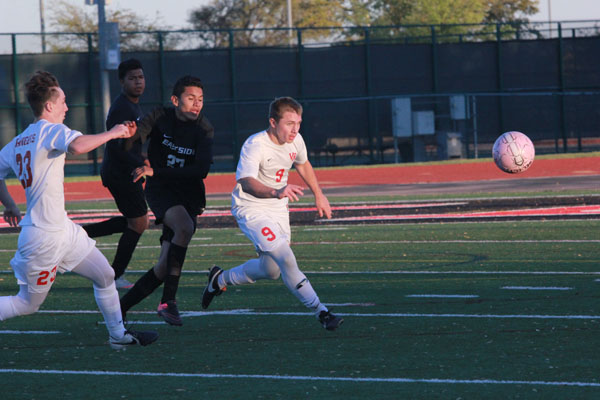 Boys soccer keeps marching after first playoff win