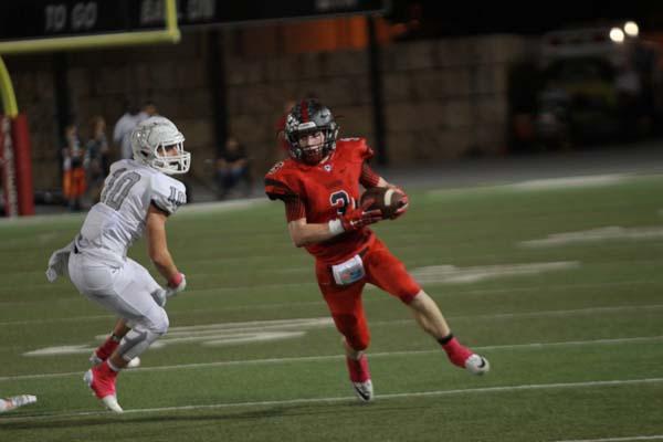 Varsity football loses nail biter to district rival