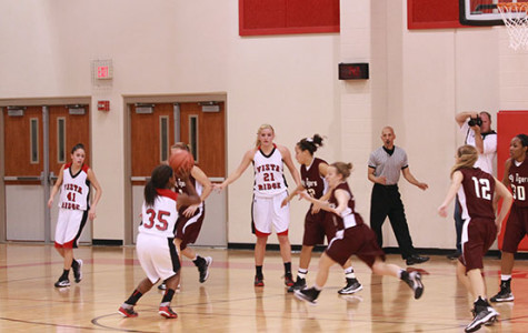 Girls' Basketball Starts District with Win