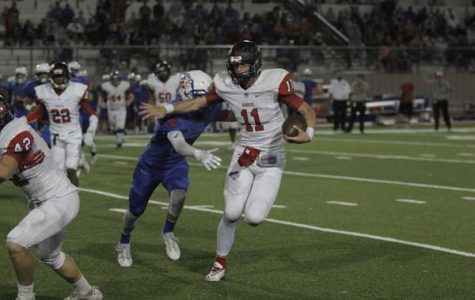 Varsity football has heart breaking defeat to district rivals