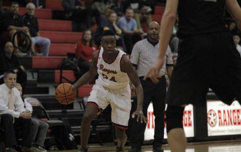 Varsity basketball wins OT thriller against Vandegrift