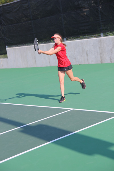 Senior varsity player Kristin Janak practices after school. Both JV and varsity teams practice daily.