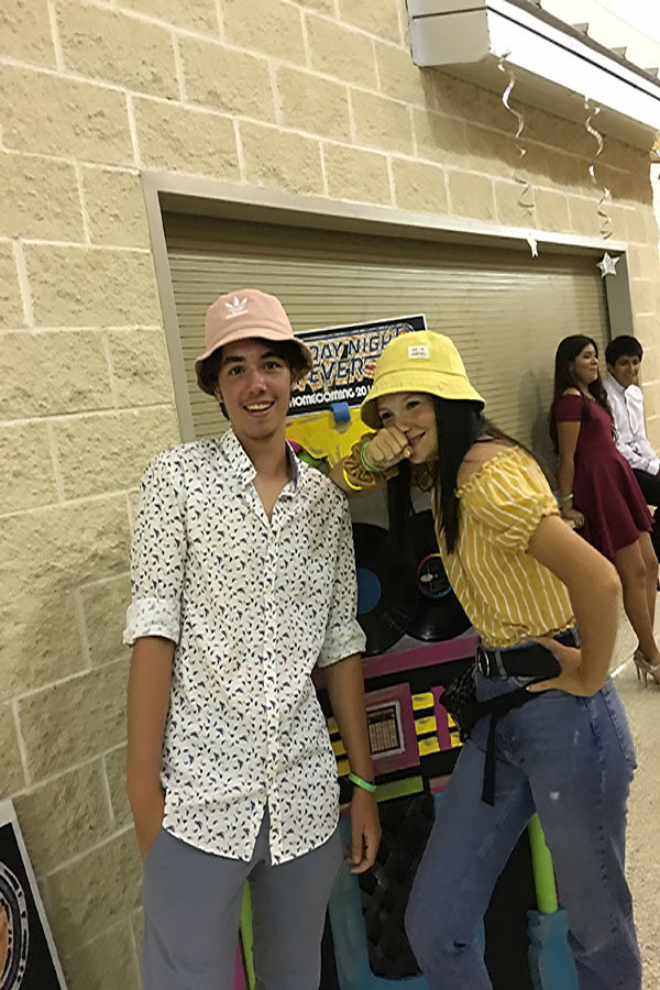Wearing matching bucket hats, Constantinos Malliaros attends his first homecoming dance with Larsen Simecek. The dance was themed Saturday Night Fever and started at 8pm.