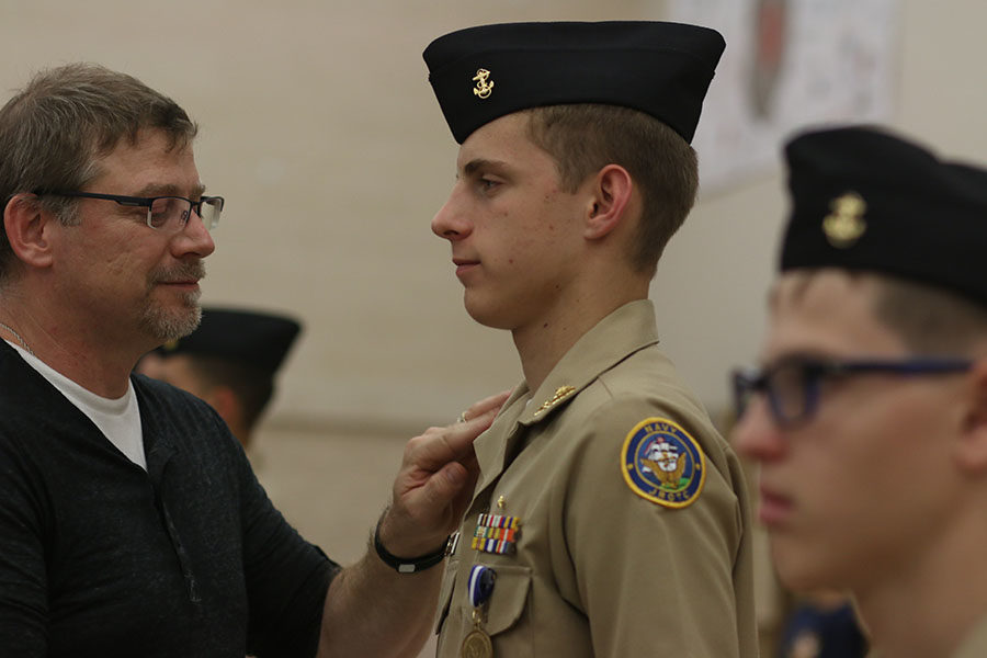 Cadet Boes gets his promotion at the annual NJROTC pinning ceremony on Oct. 9. The ceremony recognized new ranks and achievements.