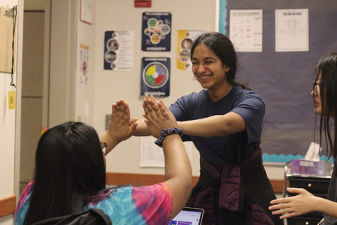 """Excitedly highfiving, sophomore treasurer Ramya Nambala and sophomore Gauri Mishra congratulate each other on successful speeches in their practice during a Youth and Government Meeting.  Nambala and Mishra spent weeks drafting and researching their bills to prepare for the District Conference on Nov. 16. """"We learn self-efficacy, self-advocacy and have confidence in expressing ourselves through speech,"""" Nambala said. """"It teaches us democratic leadership and helps us become better citizens."""""""