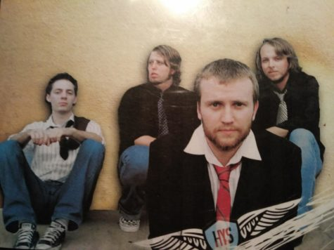 Ben Beach, in the right back corner, with his band for a picture. Together they are Hundred Year Storm.