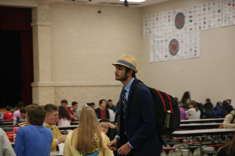 Walking through the cafeteria, Moustafa Neematallah is asked to take off his hat by the nearest AP.